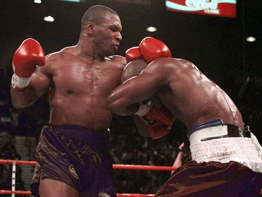 Mike Tyson and Evander Holyfield exchange punches during their WBA Heavyweight match Saturday June 28 1997 at the MGM Grand in Las Vegas.