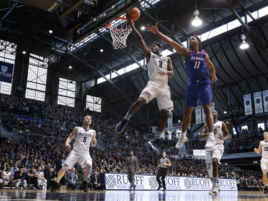 Butler Bulldogs guard Kamar Baldwin (3) drives by DePaul Blue Demons guard Eli Cain (11) in the second half of their game at Hinkle Fieldhouse Saturday, Feb 3, 2018. The Butler Bulldogs defeated the DePaul Blue Demons 80-57.