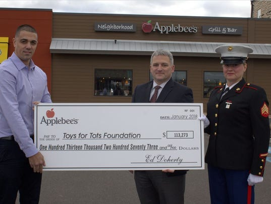 636536927293269758-Applebees-Toys-for-Tots-Check-Presentation-NJ.JPG