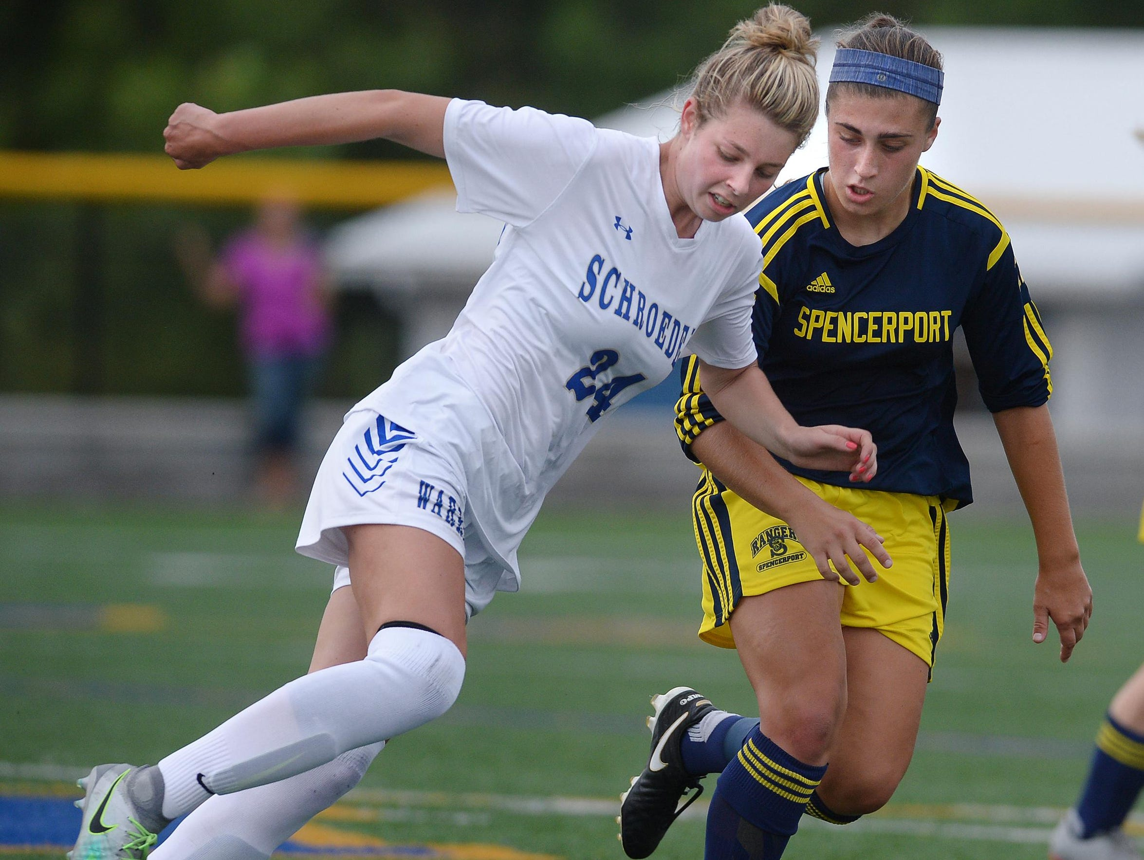 Webster Schroeder's Maddy Lowe, left, is defended by