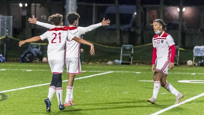 New Bedford celebrates a goal as the beat Dartmouth 3-0.