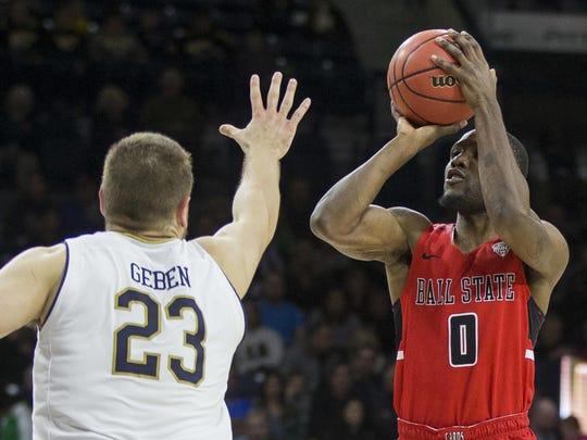 Ball State's Francis Kiapway (0) shoots over Notre Dame's Martinas Geben (23) during the first half of an NCAA college basketball game Tuesday, Dec. 5, 2017, in South Bend, Ind. Ball State beat Notre Dame 80-77. (AP Photo/Robert Franklin)