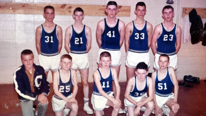 Members of the 1964-65 Cotter Junior Warriors, shown after a state tournament game at Highland, were: first row, from left, Duane Grigg, Richard Queen, Mike Parks, Roger Smith, Jimmy Kemp; second row, from left, Terry Collins, C.W. Crandall, Jim Franks, Roger Haley and Jack Burkhart.