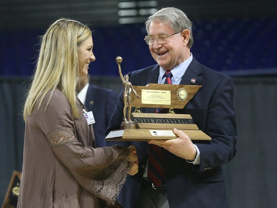 Micah Scheetz receives her 2016 Miss Basketball award from TSSAA Board of Control President Mike Reed, on Tuesday, March 8, 2016, at MTSU