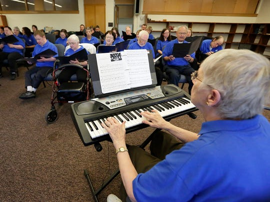 The United Singers of Fond du Lac practice recently at Sacred Heart School. The choir gives adults with physical and mental disabilities a chance to participate in the arts.