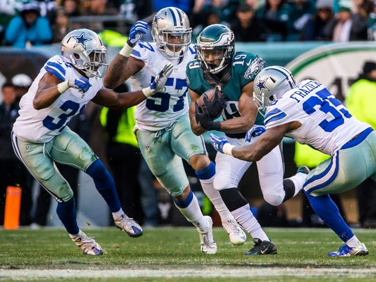 Eagles wide receiver Paul Turner cuts through a trio of Cowboys defenders in the fourth quarter of the Philadelphia Eagles 27-13 win over the Dallas Cowboys at Lincoln Financial Field in Philadelphia, Pa. on Sunday afternoon.