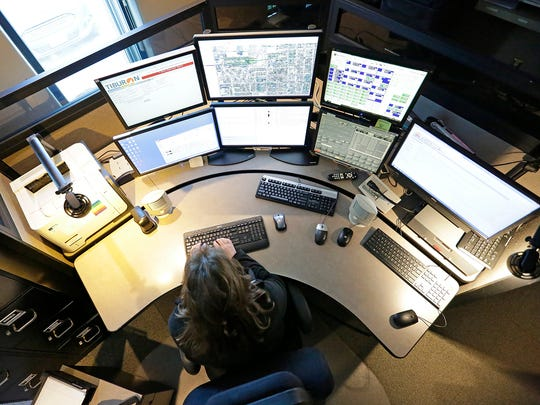 Fond du Lac 911 Center dispatcher Gina Meilahn works at a dispatching console Thursday, March 16. The system is scheduled to be upgraded in late springs with text-to-911 capabilities.