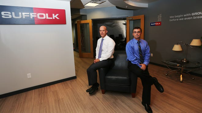 Josh Christensen, left, vice president of west coast operations for Suffolk Construction, and project executive Steve DeLong, in their new Estero offices on Monday. Suffilk moved its local offices from Fort Myers to Estero.
