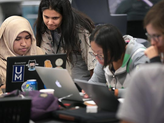 Programmers Kamrun Naher (left) and Ruchi Ruchi collaborate during the 5th annual HACKmemphis Hackathon Sunday morning at the University of Memphis. The weekend-long hackathon event is a chance for technology buff of all types to come together to work on hardware and software projects that interest them.