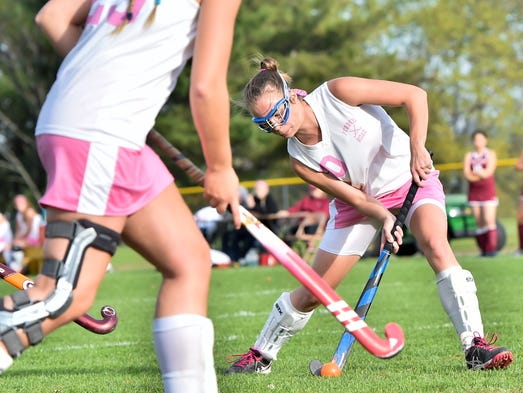 Forbes Road's Olivia Hall (00) gets ready to makes