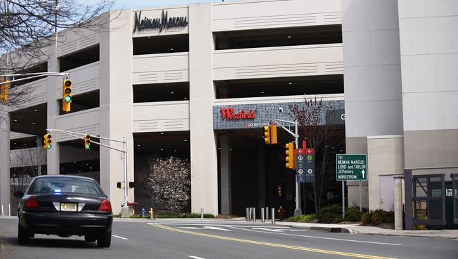 A police car next the the Nordstrom Parking deck at Garden State Plaza on Tuesday April 24, 2018.