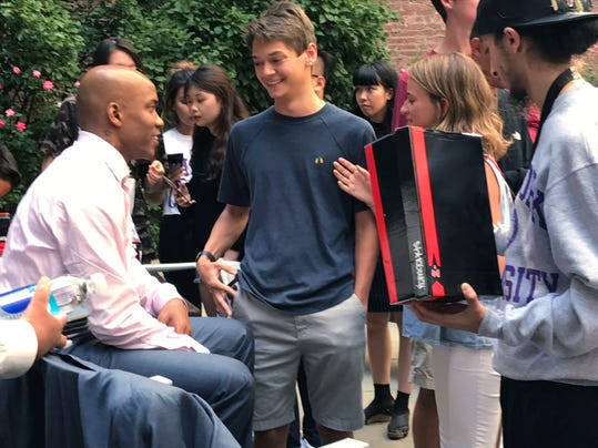 Former NBA basketball player Stephon Marbury, left, talks to NYU freshmen at a question and answer session Wednesday, Aug. 30, 2017, in New York. Marbury gave all the people in attendance a pair of his Starbury sneakers. Marbury had a few stellar seasons in China after an NBA career that included stints with five teams, and he's become an iconic figure in the country. He has a statue and was featured on a postage stamp in Beijing, and then he got a museum and a musical in his honor. (AP Photo/Doug Feinberg)