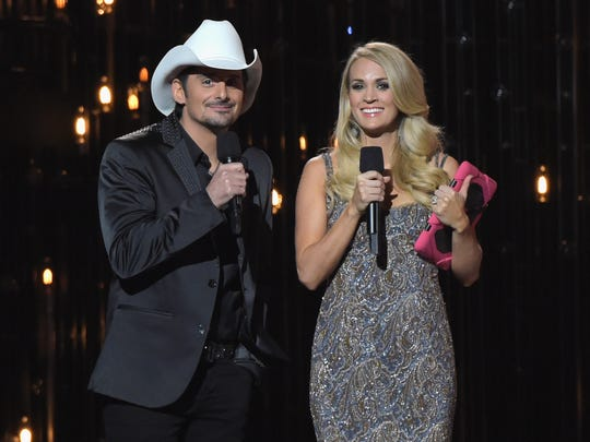 Hosts Brad Paisley and Carrie Underwood speak onstage during the 48th annual CMA Awards at the Bridgestone Arena on November 5, 2014 in Nashville, Tennessee.