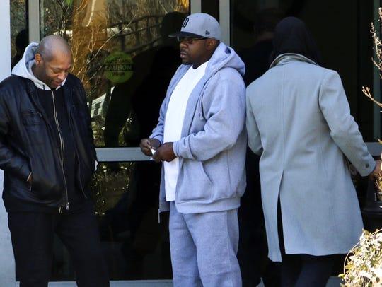 Bobby Brown, center, outside Emory Hospital in Atlanta