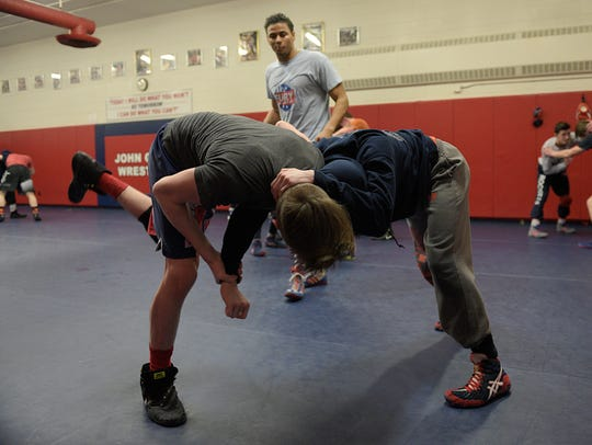 Mikey Mars (right) practices with teammate Isaac Lefler.