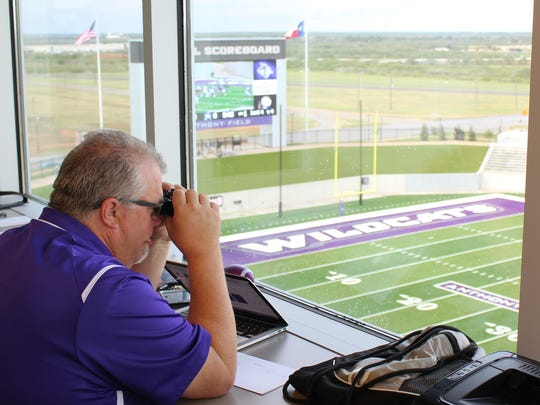Lance Fleming, associate director of athletics for media relations, gets a closer look at the action from his seat in the working press area of Wildcat Stadium. Fleming this year celebrates his 20th season at Abilene Christian University.
