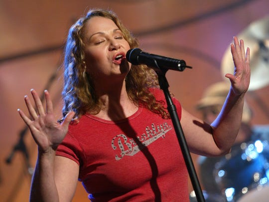 Karyn Oliver, who encompasses a touch of Joan Osborne, left, in her music, will perform Friday night at The Minstrel.