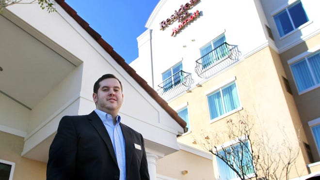 Adam Wnning is 23 and works as the assistant general manager at the Residence Inn, Gulf Coast Town Center.