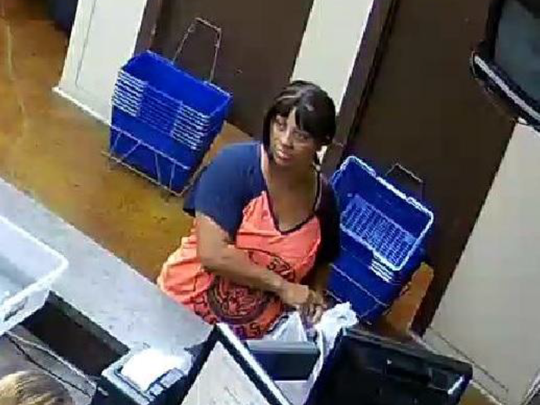 The woman who police believe stole an iPad from a child at a Scott store