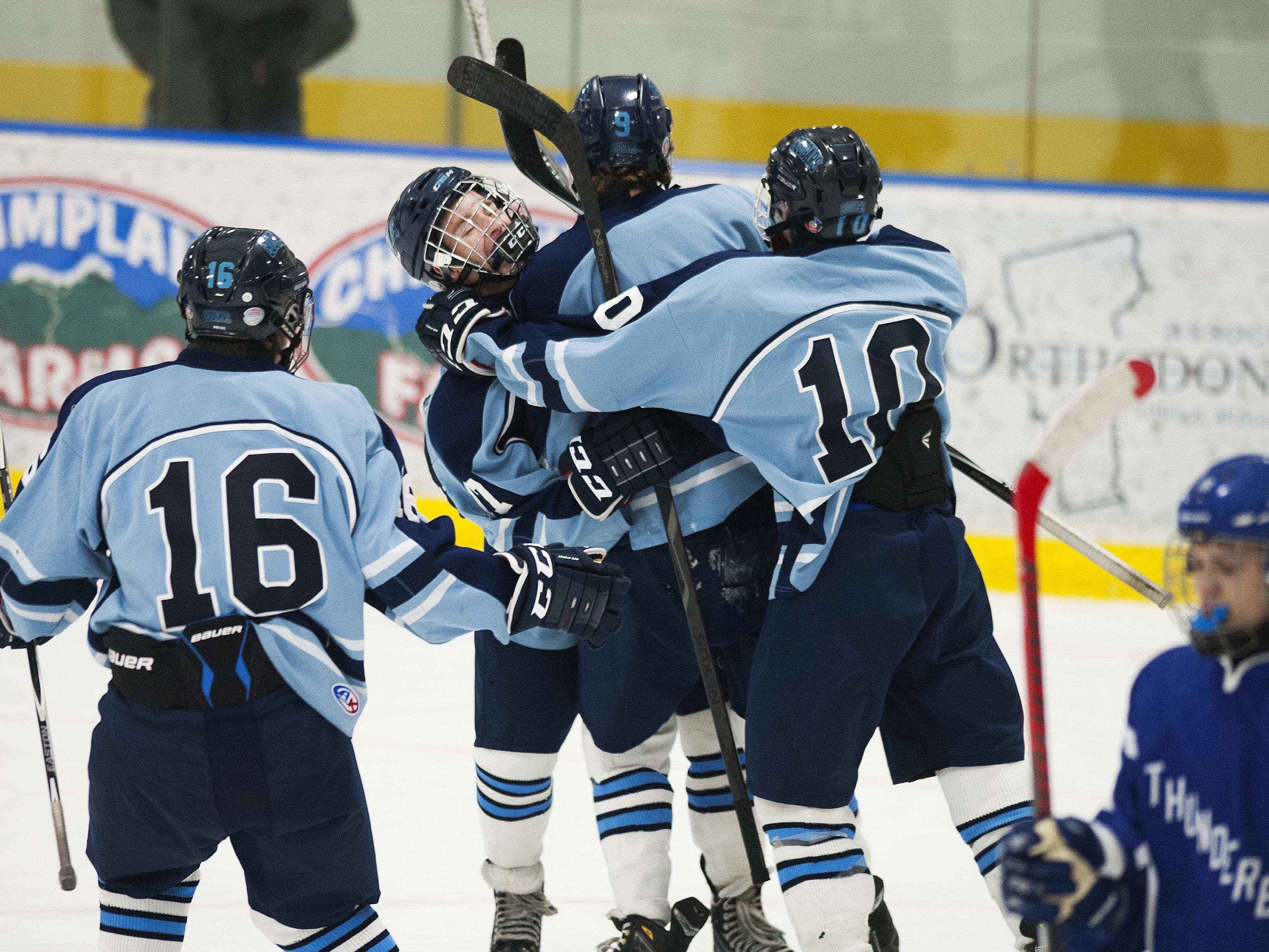 Mount Mansfield Union celebrates a goal during a high school boys hockey game against Missisquoi Valley at the Essex Skating Facility on Saturday afternoon.