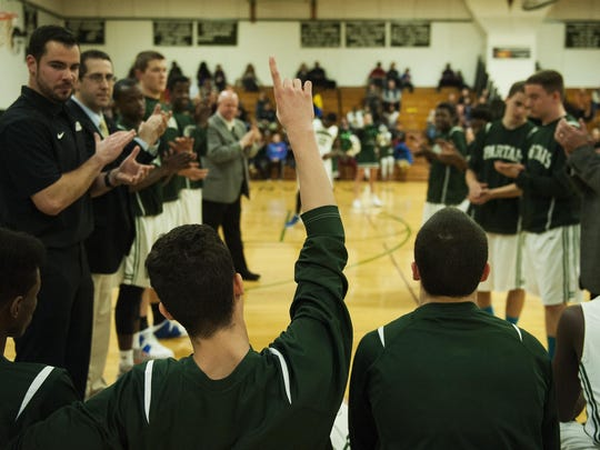 Winooski's Sean Callahan points a finger to the sky