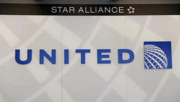 A United Airlines logo is seen behind the ticket counter at Chicago's O'Hare airport on August 13, 2013.