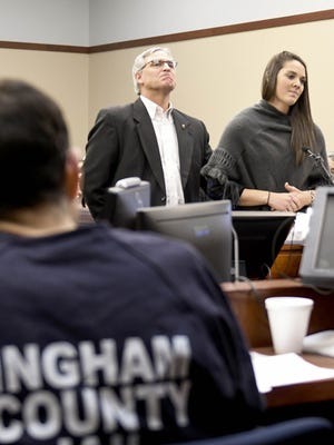 Kassie Powell address Ingham County (Mich.) Circuit Judge Rosemarie Aquilina in Lansing, Mich., on Friday, Jan. 19, 2018, during the fourth day of victim-impact statements regarding former sports medicine doctor Larry Nassar, who pleaded guilty to seven counts of sexual assault in Ingham County,  and three in Eaton County, Mich. At her side is her father, Doug Powell.