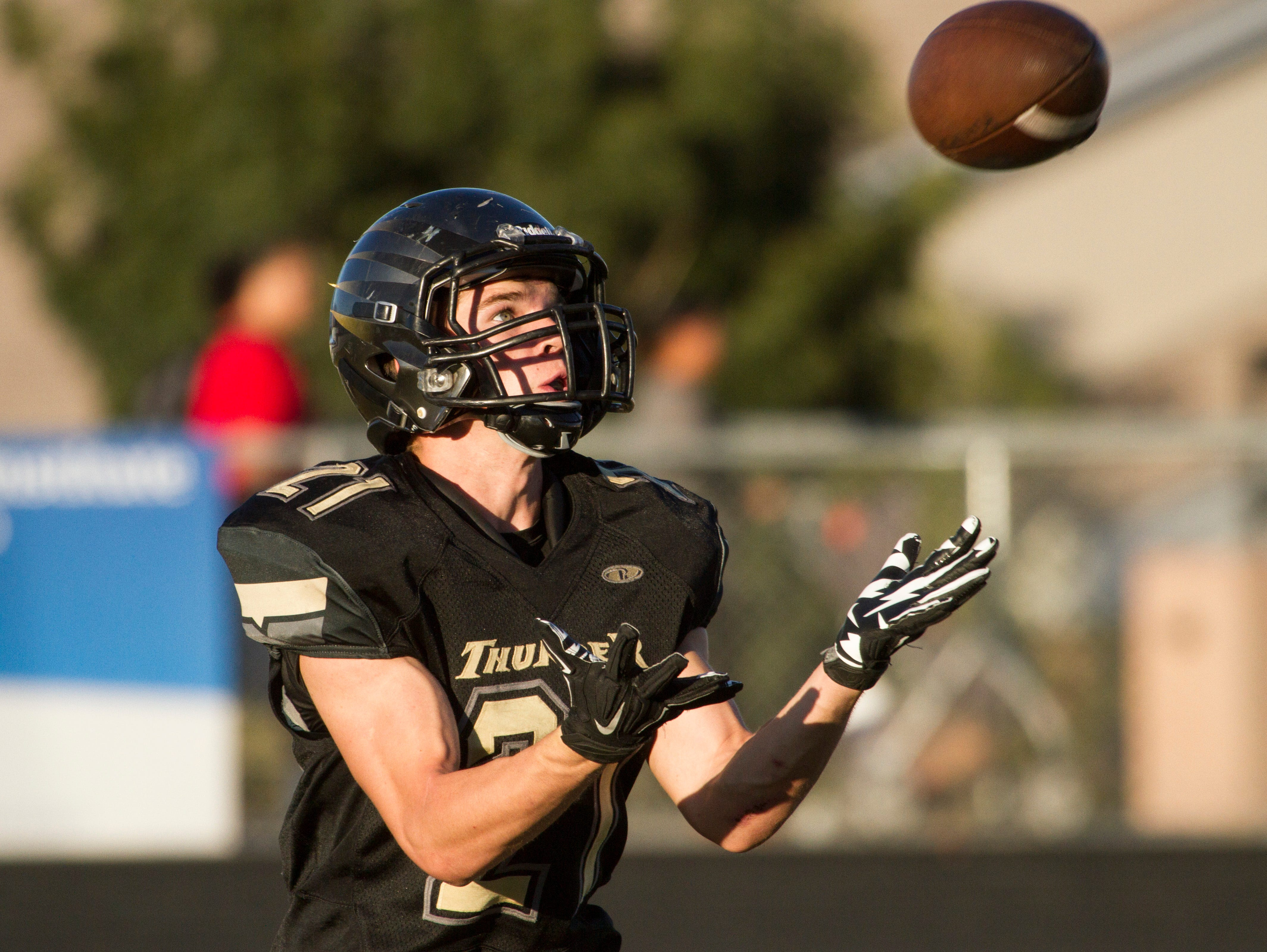 Brock Parry, from Desert Hills, returns the ball during their game against Logan High Wednesday, Oct. 14, 2015.