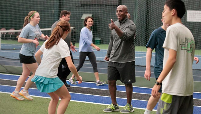 Sam Owens, fitness director at Midtown Athletic Club, calls out encouragement as he leads a speed and agility small-group training session. Such sessions are popular with members.