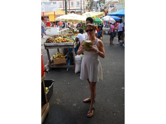 The author takes a stroll in the market with her fresh coconut