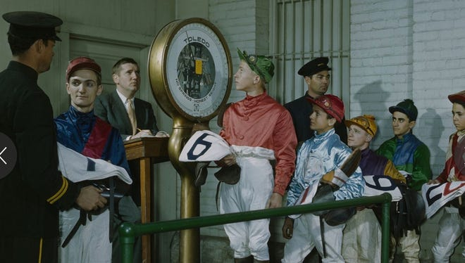 Jockey's weighing in on Kentucky Derby day at Churchill Downs. May 1940