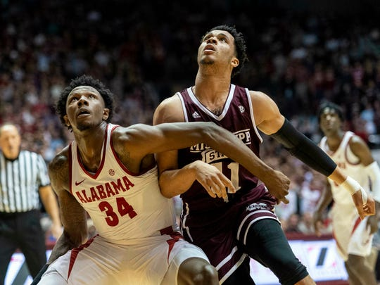 Alabama guard/forward Tevin Mack (34) and Mississippi State guard Quinndary Weatherspoon (11) battle under the basket for a rebound during the first half of an NCAA college basketball game, Tuesday, Jan. 29, 2019, in Tuscaloosa, Ala. (AP Photo/Vasha Hunt)