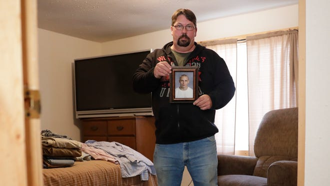 Terry Riebe stands in the bedroom he kept for his son, Ryan, who's been missing since December. On the bed and nightstand are Ryan's possessions that Terry took from the homeless shelter where Ryan had been staying.