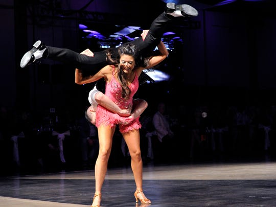 Diane Stearns, a teacher at St. John's Episcopal School, cartwheels with Diego Gonzalez, a Musical Theatre major at Abilene Christian University during Dancing with the Abilene Stars.