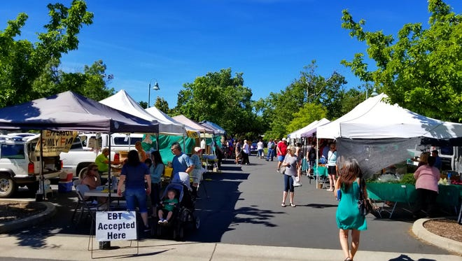 The Saturday Farmers Market behind Redding City Hall is a big draw for vendors and those looking for produce.
