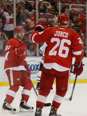 Detroit Red Wings Tomas Jurco and Tomas Tatar celebrate Sept. 23, 2015, in Detroit.