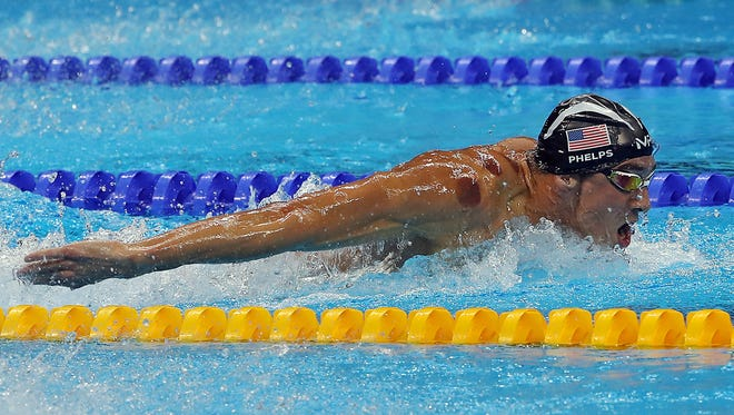 Michael Phelps (USA) competes during the men's 200m butterfly semi-finls in Rio 2016 Summer Olympic games at Olympic Aquatics Stadium.