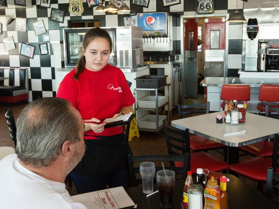 Asli Bayram takes orders from customers at the newly re-opened Pancake Alley, Thursday Dec. 29, 2017.