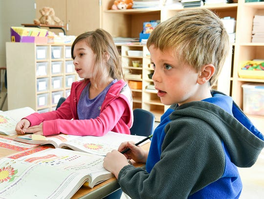 First-graders Lindsey Crandall, 5, and Levi Wade, 5,