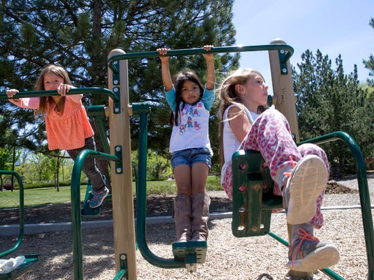 Selana Anaya, left, Aaliyah Mejia and Kresta Anaya enjoy the playground equipment Tuesday at Berg Park in Farmington.