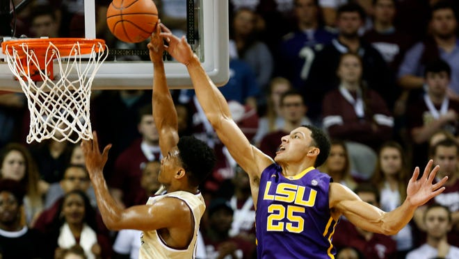 LSU's Ben Simmons (25) goes up to block the shot of College of Charleston's Cameron Johnson during first half action of an NCAA college basketball game Monday Nov. 30.