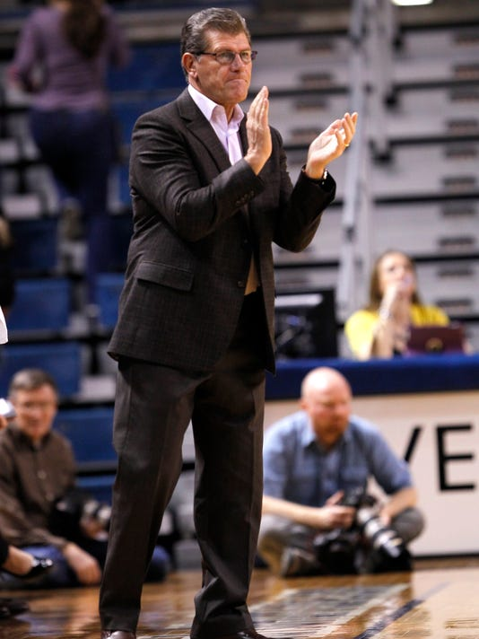 Connecticut head coach Geno Auriemma applauds his team's play against Tulsa in the first half of an NCAA college basketball game in Tulsa, Okla., Wednesday, Jan. 27, 2016. (AP Photo/Dave Crenshaw)