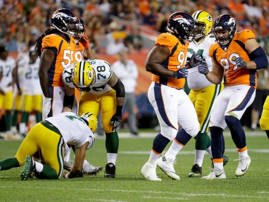 Denver Broncos defensive tackles Adam Gotsis (99) and Shelby Harris (96) celebrate their sack on Green Bay Packers quarterback Brett Hundley, left, during the first half of an NFL preseason football game, Saturday, Aug. 26, 2017, in Denver. (AP Photo/Jack Dempsey)