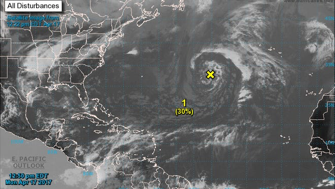 Weather officials say a low pressure system in the central Atlantic has a low chance of becoming a subtropical  cyclone over the next day