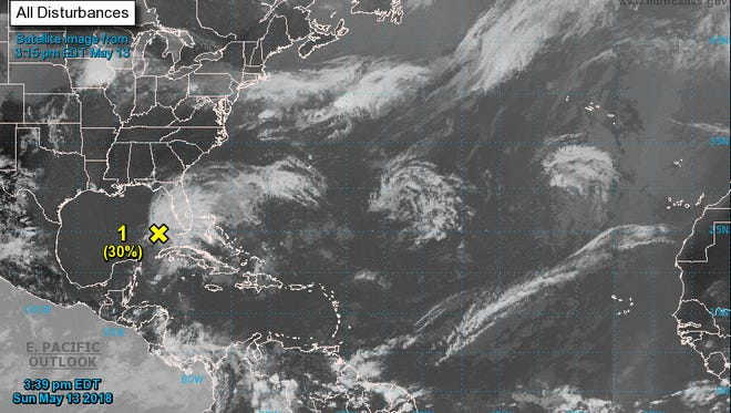 """The National Hurricane Center is monitoring a system in the Gulf of Mexico that """"could acquire"""" tropical characteristics over the next week."""