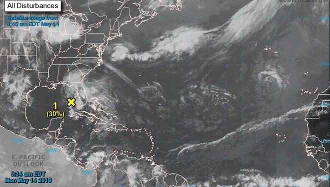 Tropical disturbance monitored in Gulf.