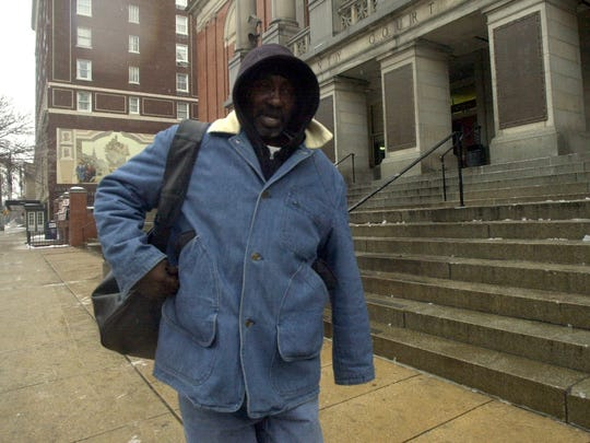 "Leon ""Smickle"" Wright leaves the York County Courthouse in 2002."
