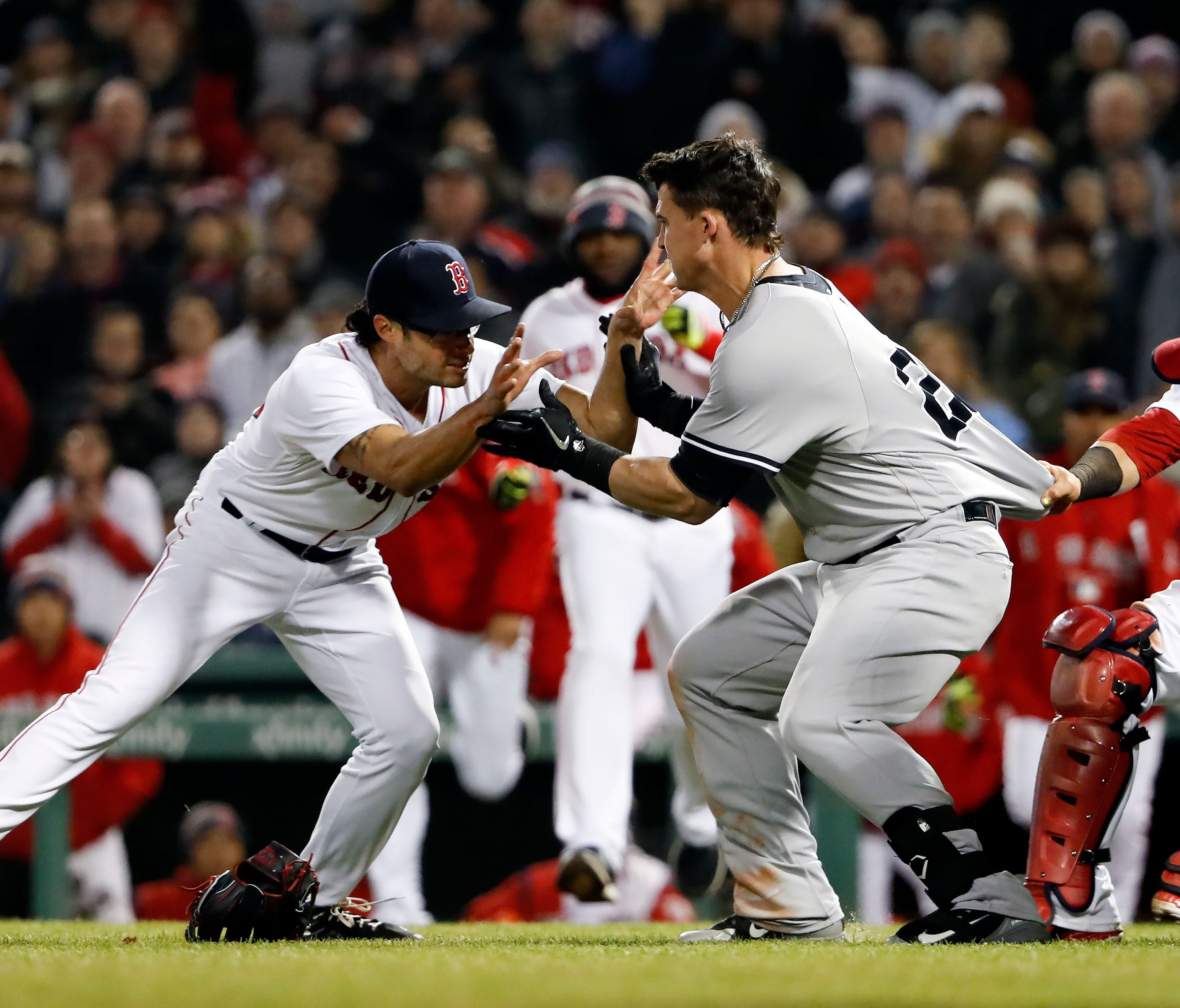 Joe Kelly (left) and Tyler Austin touched off a battle royale in the seventh inning at Fenway Park on Wednesday.