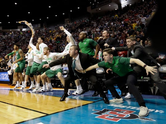 The Marshall bench look on during the second half of a first-round NCAA college basketball tournament game against Wichita State Friday, March 16, 2018, in San Diego. Marshall defeated Wichita State 81-75.(AP Photo/Gregory Bull)