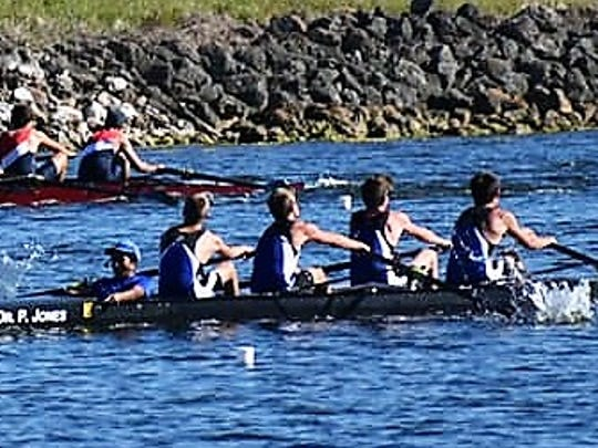 Sebastian River High School Sharks crew in black boat pushes to the finish line during a regatta in Tampa earlier in the season. Airl is a busy month as rowers will compete in district championships and state championships.